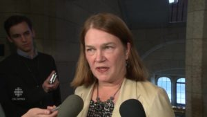 Health Minister Jane Philpott talks to reporters about the need for a National Dementia Strategy outside the Commons.